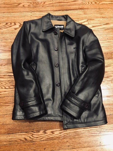Schott black leather coat.