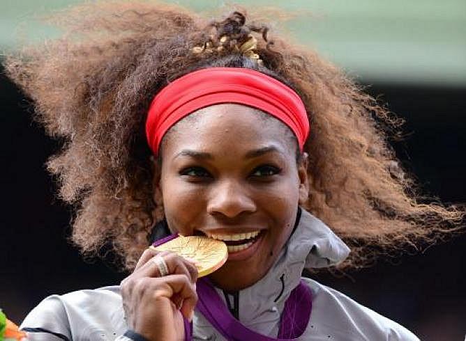 SerenaWilliamsbitingLondonOlympicsGoldMedalimg5166_668.jpeg