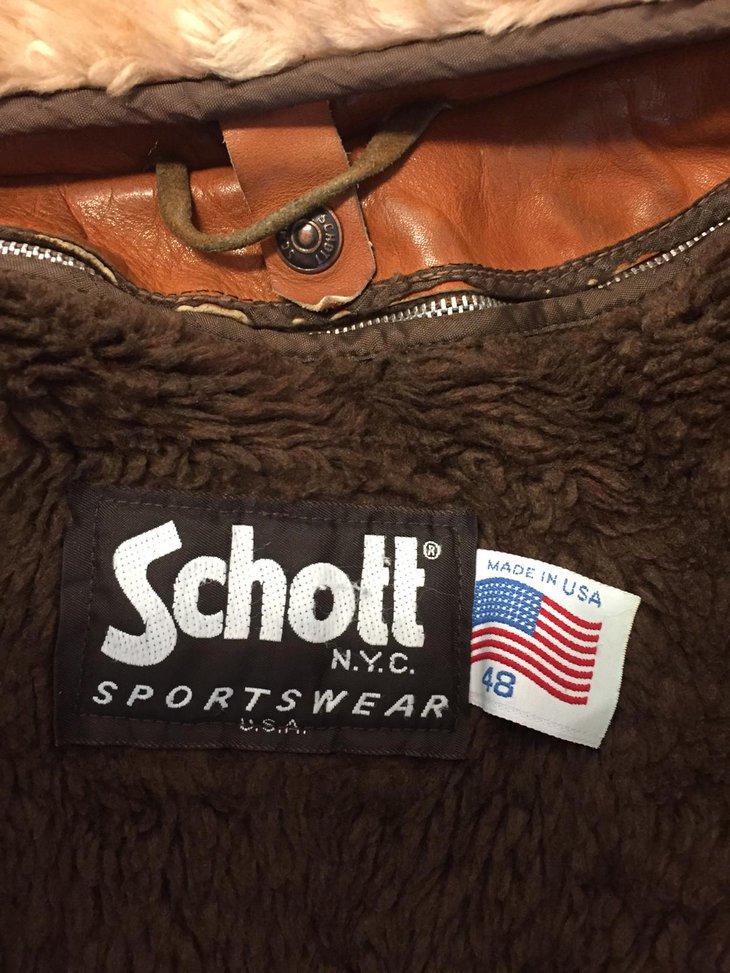 Label inside a brown leather jacket.